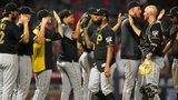 ANAHEIM, CA - AUGUST 13: The Pittsburgh Pirates celebrate a 10-7 win over the Los Angeles Angels of Anaheim at Angel Stadium of Anaheim on August 13, 2019 in Anaheim, California. (Photo by John McCoy/Getty Images)
