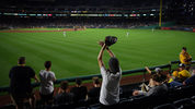 PITTSBURGH, PA - AUGUST 19: A Pittsburgh Pirates fan waves at outfielders during the game between the Pittsburgh Pirates and the Washington Nationals at PNC Park on August 19, 2019 in Pittsburgh, Pennsylvania. (Photo by Justin K. Aller/Getty Images)
