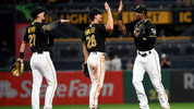 PITTSBURGH, PA: Starling Marte of the Pittsburgh Pirates celebrates with Adam Frazier and Kevin Newman after the final out in a 4-1 win over the Washington Nationals at PNC Park. (Photo by Justin Berl/Getty Images)