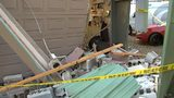Crash sends vehicle into hobby shop; 1 person hurt