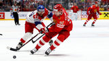 BRATISLAVA, SLOVAKIA - MAY 26: Yevgeni Kuznetsov #92 of Russia challenges Jan Kovar #43 of Czech Republic during the 2019 IIHF Ice Hockey World Championship Slovakia third place play-off game. (Photo by Martin Rose/Getty Images)