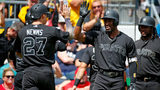 PITTSBURGH, PA - AUGUST 25: Starling Marte #6 and Kevin Newman #27 of the Pittsburgh Pirates celebrate after scoring on a three RBI triple in the second inning against the Cincinnati Reds at PNC Park  (Photo by Justin K. Aller/Getty Images)