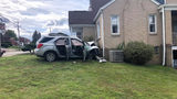 SUV crashes into home after innocent woman shot walking home from store