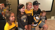 Pittsburgh Penguins forward Jake Guentzel poses with Mars native Andrew Dickson and his family after giving them their season tickets for 2019-20.