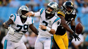 CHARLOTTE, NORTH CAROLINA - AUGUST 29: Jayrone Elliott #40 of the Pittsburgh Steelers forces a fumble from Will Grier #3 of the Carolina Panthers during their preseason game at Bank of America Stadium. (Photo by Jacob Kupferman/Getty Images)