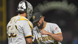SAN FRANCISCO, CALIFORNIA - SEPTEMBER 11: Elias Diaz #32 and Felipe Vazquez #73 of the Pittsburgh Pirates celebrates defeating the San Francisco Giants 9-3 at Oracle Park on September 11, 2019. (Photo by Thearon W. Henderson/Getty Images)