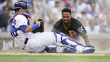 CHICAGO, ILLINOIS - SEPTEMBER 13: Pablo Reyes #15 of the Pittsburgh Pirates is out at home after being tagged by Willson Contreras #40 of the Chicago Cubs during the third inning of a game. (Photo by Nuccio DiNuzzo/Getty Images)