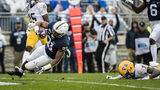 STATE COLLEGE, PA - SEPTEMBER 14: Noah Cain #21 of the Penn State Nittany Lions scores the game winning touchdown against Damar Hamlin during the second half at Beaver Stadium in State College, Pennsylvania. (Photo by Scott Taetsch/Getty Images)