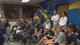 Parents, students demand answers about suspended HS football coach at school board meeting