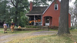 Jeep crashes into house, ending up on porch