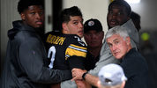 PITTSBURGH, PA - OCTOBER 06: Mason Rudolph #2 of the Pittsburgh Steelers is helped to a medical cart by teammates after being knocked out of the game in the third quarter (Photo by Justin Berl/Getty Images)