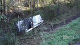 RAW: Tree trimming truck overturns