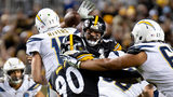 T.J. WATT (90) RUSHES PHILIP RIVERS, WHILE CAM HEYWARD LOOKS TO BAT THE PASS DOWN DURING THE CHARGERS' 33-31 WIN OVER THE STEELERS IN 2018 AT HEINZ FIELD.