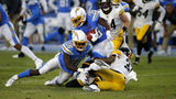 Running back Troymaine Pope #35 of the Los Angeles Chargers is tackled by cornerback Justin Layne #31 and defensive back Jordan Dangerfield #37 of the Pittsburgh Steelers during the second quarter (Photo by Katharine Lotze/Getty Images)