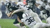 Wide receiver Brandon Sowards #16 of the Michigan State Spartans is tackled by safety Drew Hartlaub #37 and linebacker Jan Johnson #36 of the Penn State Nittany Lions during the second half at Spartan Stadium (Photo by Duane Burleson/Getty Images)