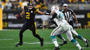 PITTSBURGH, PA - OCTOBER 28: Mason Rudolph #2 of the Pittsburgh Steelers carries the ball in front of the defense of Sam Eguavoen #49 of the Miami Dolphins during the third quarter at Heinz Field on October 28. (Photo by Joe Sargent/Getty Images)