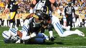 PITTSBURGH, PA - NOVEMBER 03: Jaylen Samuels #38 of the Pittsburgh Steelers carries the ball between the defense of Anthony Walker #50 and Darius Leonard #53 of the Indianapolis Colts during the first quarter. (Photo by Joe Sargent/Getty Images)