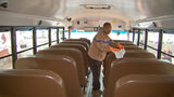 What are local school bus companies doing to stop children from getting the flu?