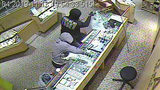 2 men armed with hammers rob jewelry store while children inside