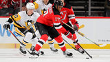 NEWARK, NEW JERSEY - NOVEMBER 15: Wayne Simmonds #17 of the New Jersey Devils takes the puck as Juuso Riikola #50 of the Pittsburgh Penguins defends in the first period. (Photo by Elsa/Getty Images)