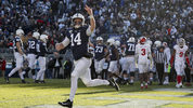 Sean Clifford #14 of the Penn State Nittany Lions celebrates after scoring a touchdown against the Indiana Hoosiers during the fourth quarter at Beaver Stadium on November 16, 2019 in State College (Photo by Scott Taetsch/Getty Images)